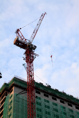Tower crane at a construction site of a high-rise commercial building photo
