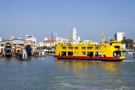 began: PENANG, MALAYSIA - DECEMBER 26: Ferry approaching George Town ferry dock on DEC 26, 2012 in Penang, Malaysia. Penang ferry service began operation in 1920, it is the oldest ferry service in Malaysia