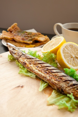Grilled fish and lemon with shallow depth of field