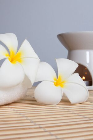 Spa Concept  Frangipani flowers, aroma candles on bamboo mats