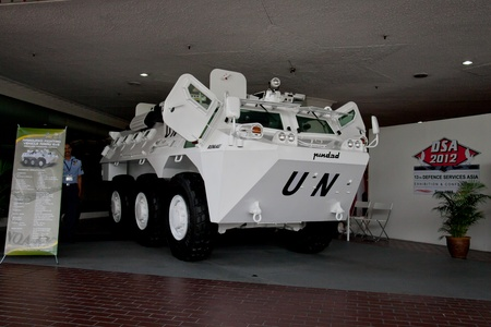 gunnery: KUALA LUMPUR, MALAYSIA-APRIL 16: RIMAU 6x6 an Indonesian made armoured fighting vehicle on display for public viewing at the Defence Services Asia 2012 on APRIL 16, 2012 in Kuala Lumpur, Malaysia Editorial