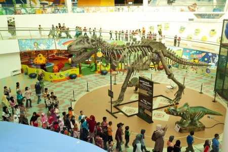 KUALA LUMPUR, MALAYSIA-MAY 12: Visitors mostly school children at the Dinosaurs Live! exhibition at the National Science Centre on May 12, 2012 in Kuala Lumpur, Malaysia. The exhibition will last until July 31, 2012.