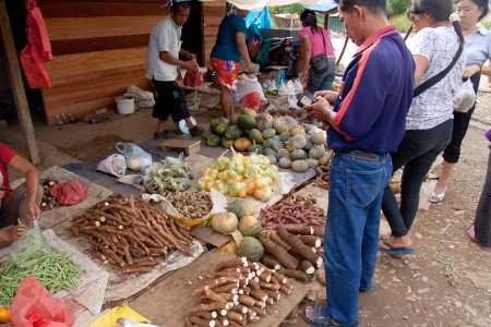 SARAWAK, MALAYSIA-JUNE 2: Buying and selling activity at the Serikin weekend market near MalaysiaIndonesia border on June 2, 2012. This market famous for its local vegetables and jungle products Editorial