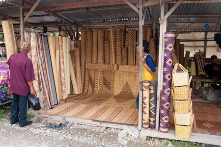 SARAWAK, MALAYSIA-JUNE 2: Kasah or traditional Bidayuhs mattress on sale at the Serikin weekend market near MalaysiaIndonesia border on June 2, 2012. Kasah is a very durable mattress made from rattan and tree bark