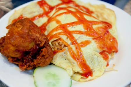 Traditional Malaysian Dishes, Nasi Goreng Pattaya or Pattaya Fried Rice served with fried chicken photo
