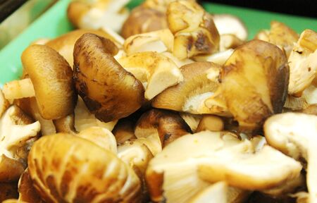 Asian dishes - sliced shiitake mushrooms for steamboat set in shallow depth of field Stock Photo - 14416789