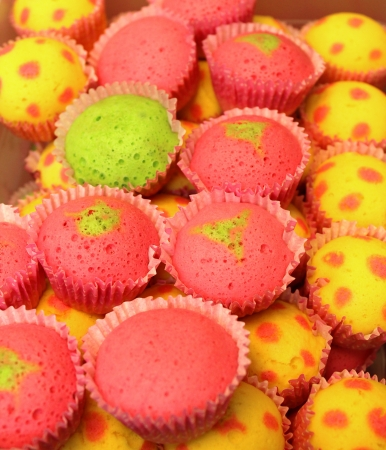 yellow heart: Colorful cupcakes set in shallow depth of field