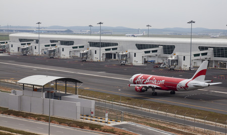 SEPANG, MALAYSIA - MAY 10  Air Asia aircraft Airbus 320 taxiing at the new low cost carrier terminal  KLIA2  Kuala Lumpur International Airport on May 10, 2014  KLIA2 start operations on May 2, 2014 and can accommodate 45 million passengers a year