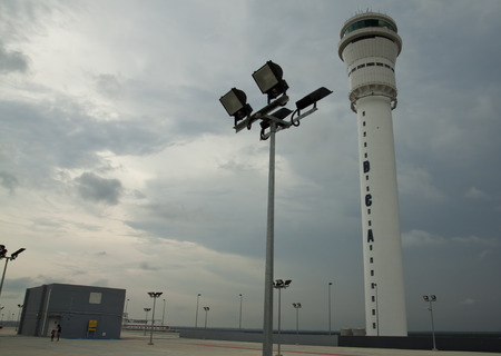 accommodate: SEPANG, MALAYSIA - MAY 10  Air control tower for the new low cost carrier terminal  KLIA2  on May 10, 2014  KLIA2 start operations on May 2 and can accommodate 45 million passengers a year