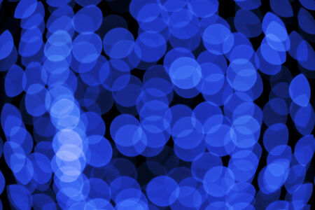 gleam: Blue abstract background with defocused bokeh lights Stock Photo