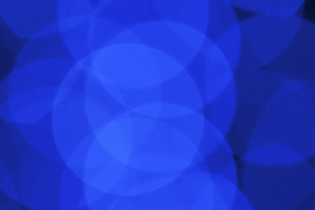 Blue abstract background with defocused bokeh lights Stock Photo