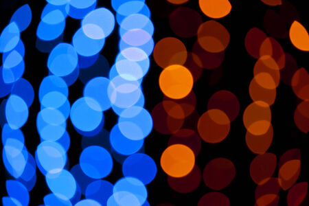 Blue and yellow abstract background with defocused bokeh lights