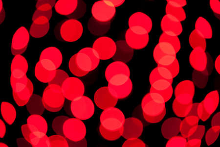 Red abstract background with defocused bokeh lights