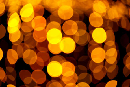Yellow abstract background with defocused bokeh lights