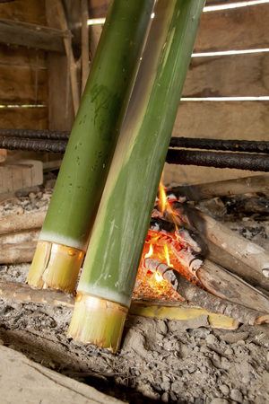 Close up of bamboo sticks over firewood kitchen  Bidayuh Land Dayak tribe use bamboo stick for cooking rice, meat or vegetable
