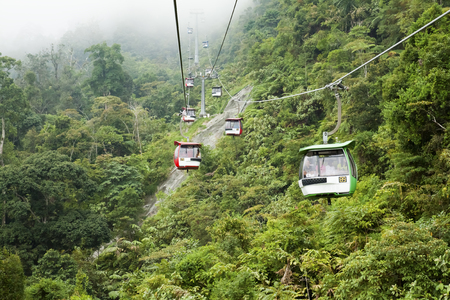 PAHANG, MALAYSIA - AUGUST 8  Visitors travel on Genting Skyway cable cars on August 8, 2013 in Pahang, Malaysia  Genting Skyway is a gondola lift connecting Gohtong Jaya Town and Resorts World Genting Highland Editorial