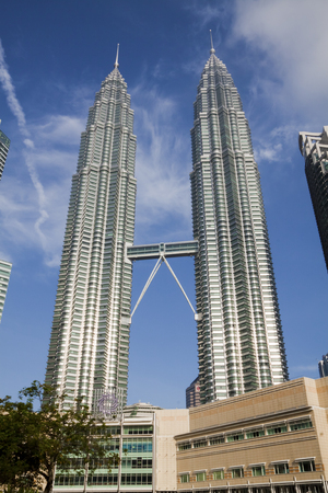 KUALA LUMPUR, MALAYSIA - NOVEMBER 26  Morning view of Petronas Twin Towers on November 26, 2011 in Kuala Lumpur, Malaysia  The towers were the tallest buildings in the world for six years, until Taipei 101 was completed in 2004