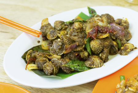 Malaysian cuisine. Cockles cooks in spicy sambal chillies