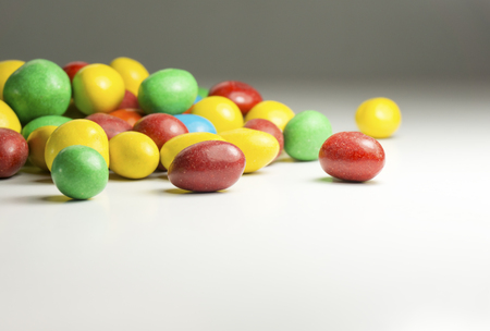 Close up of colorful chocolate coated candy. Shallow depth of field