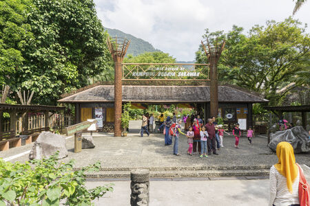 SARAWAK, MALAYSIA - NOV 7: View of entrance gate to Sarawak Cultural Village on November 7, 2014 in Sarawak, Malaysia. Located at the foothills of legendary Mount Santubong, this living museum depicts the heritage of the major racials group in Sarawak