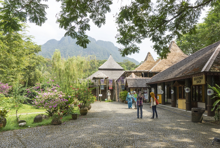SARAWAK, MALAYSIA - NOV 7: Visitors at the Sarawak Cultural Village on November 7, 2014 in Sarawak, Malaysia. Located at the foothills of legendary Mount Santubong, this living museum depicts the heritage of the major racials group in Sarawak Editorial
