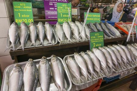 KUCHING, MALAYSIA - NOV 9: Fish vendor selling salted Terubok at the Satok Wet Market in Kuching, Sarawak on November 9, 2014. Terubok (Tenualosa toli) is highly prized among Malaysians for its meat and eggs Editorial