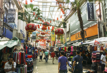 malaysia culture: KUALA LUMPUR, MALAYSIA - January 17, 2015: Petaling Street is a Chinatown which is located in Kuala Lumpur, Malaysia. It usually crowded with locals as well as tourists looking for bargained clothes