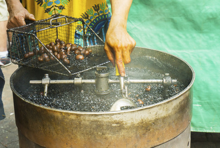 Coffee roasted chestnuts being sold at stalls in Chinatown Malaysia Stock Photo