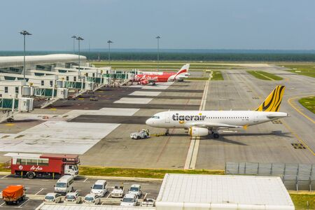 SEPANG, MALAYSIA - SEPTEMBER 16, 2015: Kuala Lumpur International Airport Terminal 2 on September 16, 2015. Flights to and from Sumatra, West Kalimantan, Singapore and Sarawak were either diverted, delayed or cancelled due to worsening haze