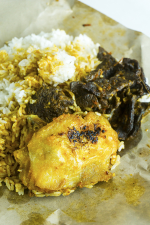 Traditional Malaysian Cuisine. Steamed rice, fried chicken and beef lung cooked in hot spicy sambal