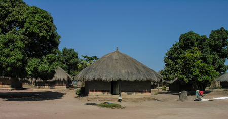 Near Pweto, Katanga, Democratic Republic of Congo, 11th June 2005: Woman and child standing next to their hut Stock Photo
