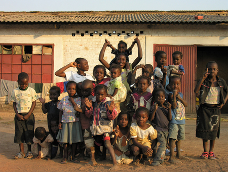 Lubumbashi, Democratic Republic of Congo, circa May 2006: Group of children posing for the camera in the yard of an abandoned factory. In the  industrial quarter of the city there are several former factories now reutilized as improvised living quarters