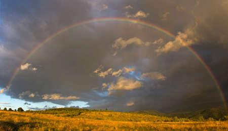 Rainbow over the forest in Transylvania Standard-Bild