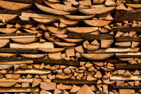 Woodpile of pine in stack for firewood