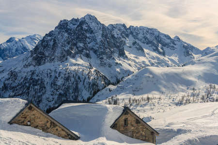 sublime: Alpine scenery with snow covered houses and ski Stock Photo