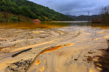 residual: Polluted water flooded village by copper mining Romania