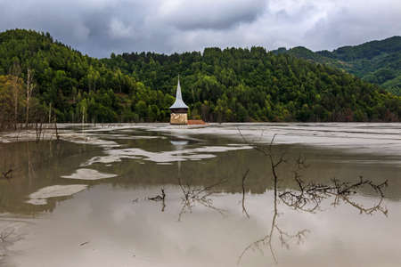 inundated: Church of polluted lake by mining in Romania