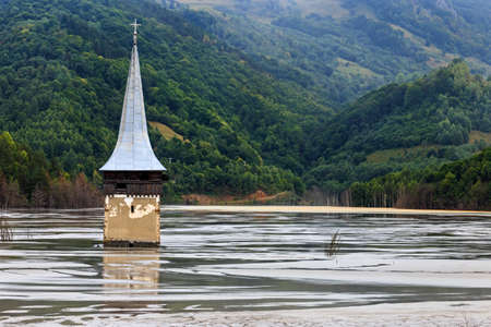 inundated: Flooded church in polluted lake by mining in Romania