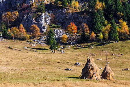 haycock: Autumn mountain landscape with haycock in the meadow. Stock Photo
