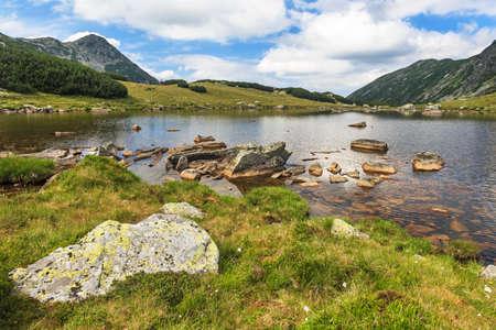 lake shore: Glacier lake shore with rocks and grass, Retezat mountains, Romania Stock Photo