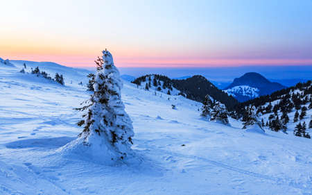 Winter sunset in snowy mountain, Transylvania, Romania