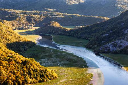 Rijeka Crnojevica river curve summer in Montenegro Standard-Bild