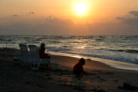Chair beach on sand in the summer vacation travel beautiful summer landscape sunrise on the beach with sea and playing child Standard-Bild