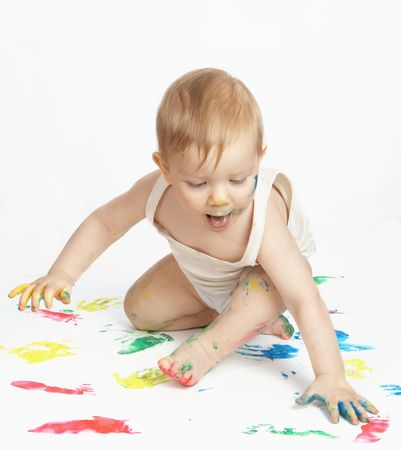 The small child draws water paints photo