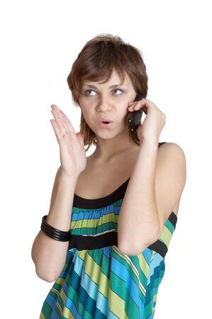 beautiful girl speaking by phone emotionally photo