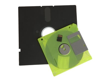 floppy disks and flash drive on white photo