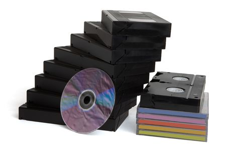Videocassettes and dvd disk on white photo