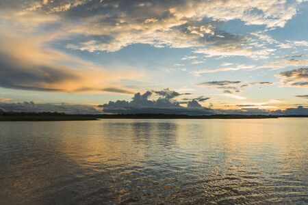 Sunset in the Amazonas River, it was a distant boat ride from Iquitos. Banque d'images