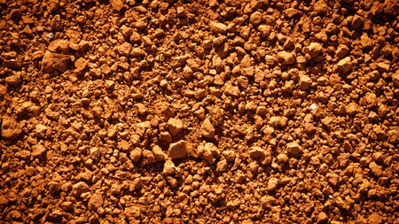 Red dirt (soil) background Stock Photo