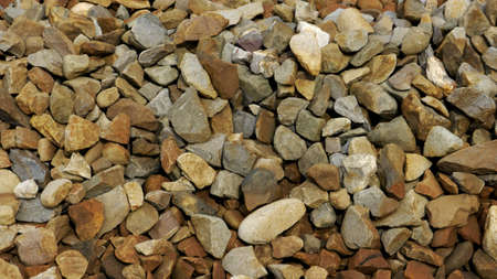 Crushed Stone Background (Texture). Pile of trackbed ballast used to support the sleepers on a railway track Stock Photo